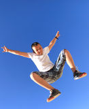 Flying bouncing boy with  sky. Flying bouncing boy with clear blue sky Stock Image