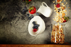 Flying breakfast against grey wall Royalty Free Stock Photo