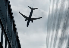 Flying between buildings Royalty Free Stock Photos