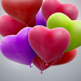 Flying bunch of balloon hearts Stock Images