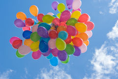 Flying bunch of colorful balloons Stock Photos
