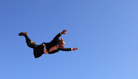 Flying businessman. Professional skydiver flying with a businessman suit Stock Image