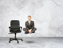 Flying businessman in lotus posture Royalty Free Stock Photo
