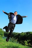 Flying businessman outdoor in summer full body. Flying businessman outdoor in summer day full body Royalty Free Stock Images