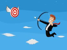 Flying businessman shooting arrow at target Stock Image