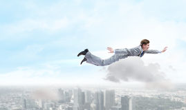 Flying businessman Royalty Free Stock Image
