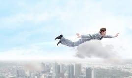 Flying businessman Royalty Free Stock Image