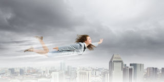 Flying businesswoman Stock Photo