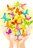 Flying butterflies in hands, vector illustration Royalty Free Stock Image