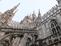 Flying Buttresses and Detail of Milan Cathedral. Low Angle Architectural Close Up View of Historic Milan Cathedral Church with Focus on Decorative Flying Stock Photography