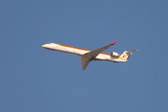 Flying Canadair CRJ aircraft, Iberia international flight Royalty Free Stock Photos