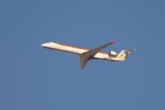 Flying Canadair CRJ aircraft, Iberia international flight Royalty Free Stock Photos