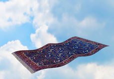 Flying carpet on blue sky. Surrealistic flying carpet against blue sky and white clouds. 3D rendering Royalty Free Stock Photos