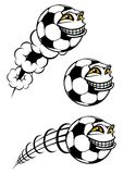 Flying cartooned soccer or football ball Stock Photo