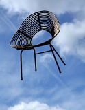 Flying chair royalty free stock photography