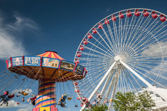 Flying chair and Ferris wheel Stock Photography