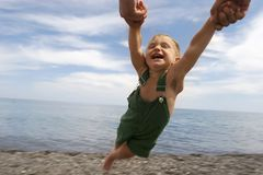 Flying child. On beach background Royalty Free Stock Image