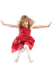 Flying childhood. Adorable caucasian 5 year old girl flying high stock photography