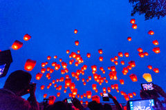 Flying Chinese Sky Lanterns. Large group of flying chinese sky lanterns taking off.  One of the must participate event in Taiwan.  The event is usually held one Stock Photos