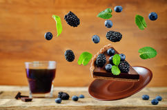 Flying chocolate tart with blackberries and blueberries Royalty Free Stock Photography