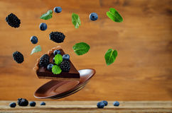 Flying chocolate tart with blackberries and blueberries Stock Photo
