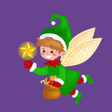 Flying Christmas elf isolated with wings and magic wand star in a green suit with bag of sweets, assistant of Santa Stock Photos
