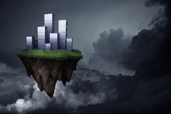 Flying city. Financial city island flying over dark cloudy skies of uncertainty Stock Photo