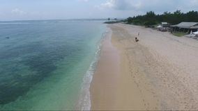 Flying close over tropical sandy beach and waves. Flying close over tropical sandy beach and ocean waves stock video footage