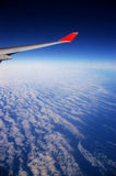 Flying on a cloud Royalty Free Stock Photos