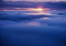 Flying between the cloud at sunset. Inspirational flight Royalty Free Stock Photo