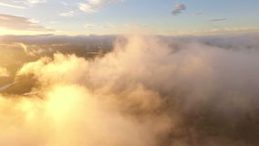 Flying in the clouds. Beautiful sunset stock video footage