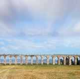 Flying clouds over aqueduct Royalty Free Stock Image