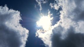 Flying clouds the sun rays stock footage