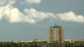 Flying clouds. Clouds under high-rise building time lapse stock footage
