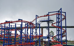 Flying coaster track. With cloudy scene background Stock Images