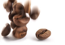 Flying coffee beans. On a white background, close-up Stock Image