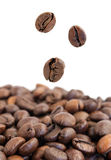 Flying coffee beans Royalty Free Stock Images