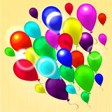 Flying colorful balloons. Colorful, bright and shiny balloons on light background in fine striped inflated with helium rise up Royalty Free Stock Images