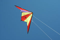 Flying a colorful kite Stock Image