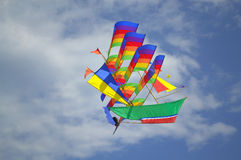 Flying colorful sailing ship kite Stock Photos