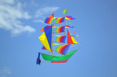 Flying colorful ship kite Royalty Free Stock Photos