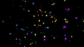 Flying colorful stars. On a black background stock video