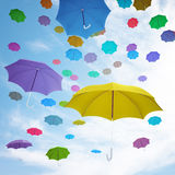Flying  colorful umbrellas Stock Photos