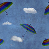 Flying colorful umbrellas on blue sky Royalty Free Stock Images