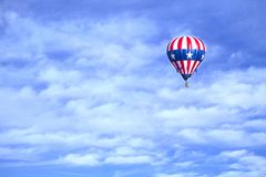 Flying colors. When you see flying hot air balloons you know you just have to capture the moment, it shows adventure, and the colors are fun Stock Photography