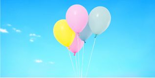 Flying coloured balloon on blurred sky background. Isolated on blue royalty free stock images