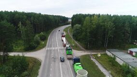 Flying a column of trucks without movement, shipping, road, highway, moving the camera forward.