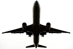 Flying commercial airplane isolated on white Royalty Free Stock Photo