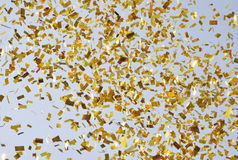 Flying confetti in sky Royalty Free Stock Image