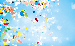 Flying confetti in sky with copy space Royalty Free Stock Images